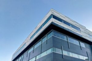 What is a rainscreen cladding system and what are its advantages?